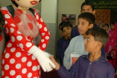 Gogi shaking the kids hands Kot Radha Kishan