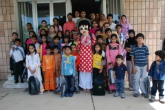 Group picture of the kids and Gogi